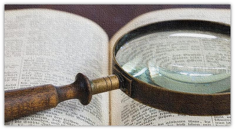Bybel en vergrootglas