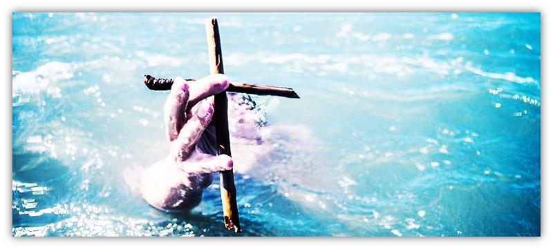 hand met kruis